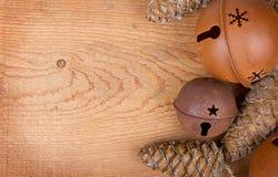 Christmas ornaments on wood panel Royalty Free Stock Photos