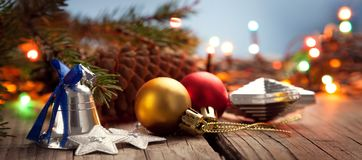 Christmas ornaments on a wood table with a nice festive backgrou. Nd Xmas illuminations royalty free stock image