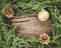 Christmas ornaments on wooden background as frame border with co Stock Photo