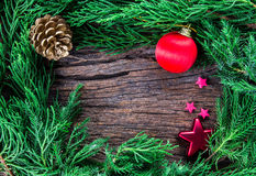 Christmas ornaments on wooden background as frame border with co Royalty Free Stock Photo