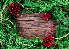 Christmas ornaments on wooden background as frame border with co Royalty Free Stock Photos