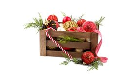 Christmas ornaments in a wooden crate Royalty Free Stock Photos