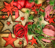 Christmas ornaments, wooden stars, red ribbons and pine tree bra Stock Photo