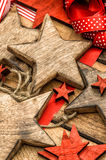 Christmas ornaments wooden stars and red ribbons Royalty Free Stock Images