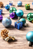 Christmas ornaments on wooden surface Stock Photos