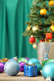 Christmas ornaments on wooden surface wth green background Royalty Free Stock Photography