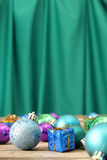 Christmas ornaments on wooden surface wth green background - Series 2 Royalty Free Stock Images