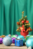 Christmas ornaments on wooden surface wth green background - Series 2 Stock Photo