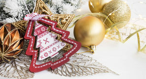 Christmas ornaments with wooden tree, golden star and balls ligh Royalty Free Stock Photography