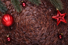 Christmas ornaments and xmas tree on dark holiday background Royalty Free Stock Images