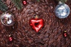 Christmas ornaments and xmas tree on dark holiday background. Xmas theme and Happy New Year Royalty Free Stock Photo