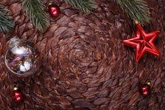 Christmas ornaments and xmas tree on dark holiday background. Xmas theme and Happy New Year Royalty Free Stock Image