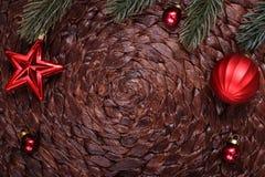 Christmas ornaments and xmas tree on dark holiday background. Xmas theme and Happy New Year Royalty Free Stock Photography