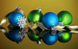 Christmas ornaments on yellow background Stock Image