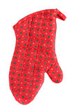 Christmas oven glove. Bright red christmas oven glove with tree decorations Royalty Free Stock Photography