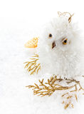 Christmas owl and decoration on a white snow. Christmas bright c Royalty Free Stock Images