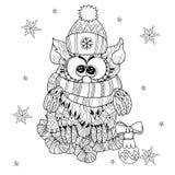 Christmas Owl on fir tree branch Royalty Free Stock Photo
