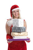 Christmas packages. Cute young girl standing with a pile of presents in her hands Stock Photography