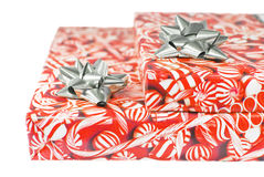 Christmas Packages. Two stacked wrapped christmas gifts, white iso Stock Photography
