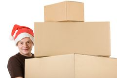Christmas packages. Young man with a christmas cap who lifts up a pyramid of blank packages blank for your own text Stock Image
