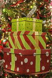 Christmas Packages. In front of a Chrsitmas tree royalty free stock image