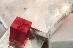 Christmas Packages. Red and White wrapped Christmas Presents sitting under tree Stock Images
