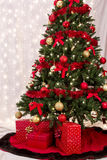 Christmas packages under the tree. Three wrapped Gifts under a Christmas tree Stock Image