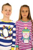 Christmas pajamas portrait of a girl and a boy Royalty Free Stock Image