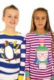 Christmas pajamas portrait of a girl and a boy Royalty Free Stock Image