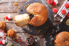 Christmas panettone bread with dried fruit and festive decoratio Stock Image
