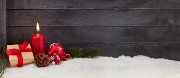 Christmas panorama background with candle. Christmas panorama background with red candle and gift Royalty Free Stock Photography