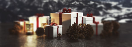 Christmas panorama banner of gifts and candles. Arranged in a line with pine cones with focus to the central gift with red ribbon on a backdrop of snowy winter Royalty Free Stock Image
