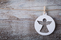Christmas paper angel decoration hanging over wooden background.  Royalty Free Stock Image