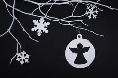 Christmas paper angel and snowflake decoration hanging over blac Stock Photography