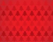 Christmas Paper Background. A Red Christmas-Themed Background with christmas trees Royalty Free Stock Image