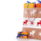 Christmas Paper Bag with Orange Presents Royalty Free Stock Photo