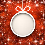 Christmas paper ball on red background. Stock Image