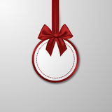 Christmas paper bauble with bow on the white Stock Image