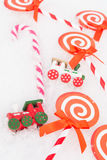 Christmas paper candy, real candy and trains Stock Photos