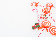 Christmas paper candy, real candy and two trains Stock Image