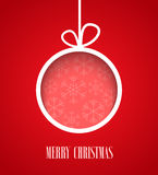 Christmas paper card with hanging toy. Stock Photos