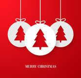 Christmas paper card with hanging toy. Royalty Free Stock Photos