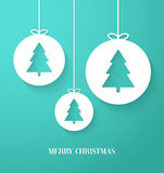 Christmas paper card with hanging toy. Stock Photo