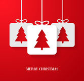 Christmas paper card with hanging toy. Stock Image