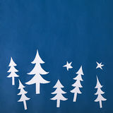 Christmas paper decorations on blue background Stock Image
