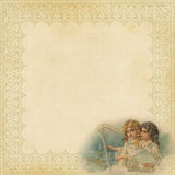Christmas Paper with fancy frame and angels. Blank textured Christmas background Paper with fancy filagree frame and vignette of Victorian style angels singing Stock Image