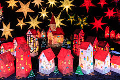 Christmas paper houses at a Christmas market Stock Photography