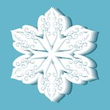 Christmas paper snowflakes on blue background. Royalty Free Stock Image