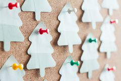 Christmas paper tree reminder on cork board abstract background Royalty Free Stock Image