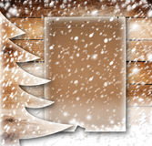 Christmas paper tree on the snow-covered  background Stock Image
